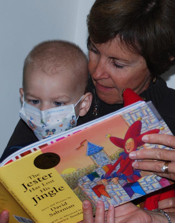 Grandma Reading to Grandson in Mask