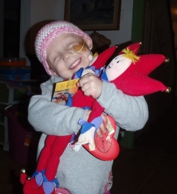 Rena hugging doll